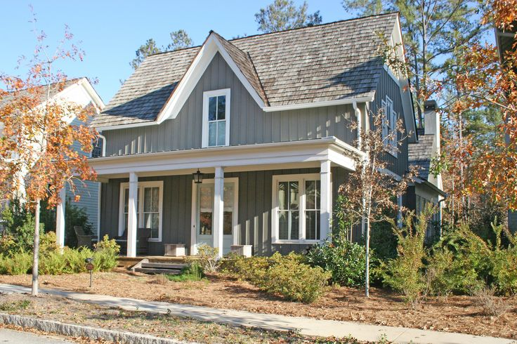 Roof line porch vertical siding low maintenance siding for Cottage siding