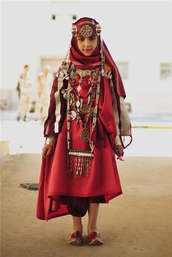 Africa | A girl wearing a folk costume participates in the Carnival Benghazi, Libya's 2013 Capital of Culture | Photographer unknown