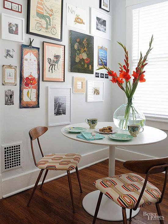 Subtlety is essential to midcentury design. Small details, like geometric seat pads, elevate basic dining chairs with understated wishbone backs. An array of vintage artwork adds interest around the Saarinen-inspired tulip table./