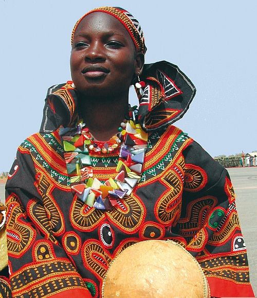 Africa | Woman wearing the traditional dress from Cameroon | Photographer unknown