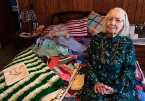 Ellen Vossler, 97, sits in her room at her daughter Rose Hollingsworths house in Cairo, Neb., with various items she made by hand throughout her life. She said she cant count the number of afghans, quilts, blankets, items of clothing, dolls and  beaded necklaces that she has made and given away to family, friends, neighbors, those with cancer and even homeless people. Take nothing, make it into something, and then give it away. (Independent/Matt Dixon)