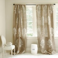 burlap curtains with stencil. Could do this on the drop cloth curtains.