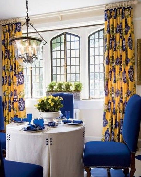 use bold yellowblue patterned drapery panels with vibrant blue chair upholstery to create a provincial ambiance sunshine inspired jackie curtain
