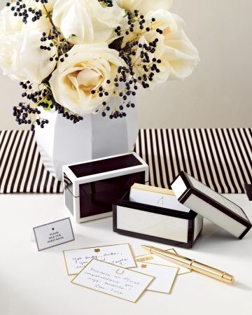 Set out lacquer containers holding cards stamped with lucky talismans, like horseshoes and wishbones, and have guests jot down their sentiments. Post-wedding, keep the boxes on your desk for easy perusal whenever you're feeling nostalgic.