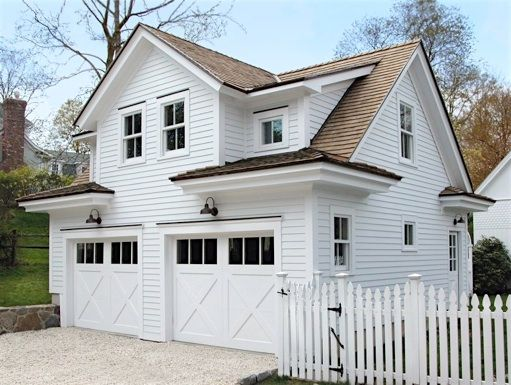 Charming.  I assume that this is a double garage with 2 doors and space for something, work space or guest space?, on the second floor.  Looks like a little house with 2 garage doors in front.   Gable inside shed dormer.