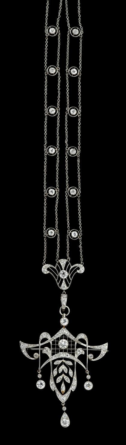 Platinum and diamond necklace   edwardian   Unusual necklace displaying twenty-three collet set Old Mine cut diamonds along a double platinum chain finishing in a removable ribbon motif pendant pave and collet set with sixty Old Mine and chip cut diamonds, total carat weight approximately 1.1 carats. Pendant can be worn as a brooch.