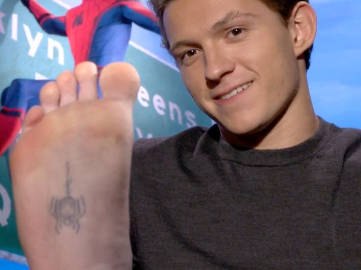 """'Spider-Man: Homecoming' actor Tom Holland got a tattoo on the bottom of his foot after landing his starring role - The INSIDER Summary: """"Spider-Man: Homecoming"""" actor Tom Holland got a tattoo of a spider on the bottom of his foot to commemorate nabbing the role. He showed it off during a press tour for the film. Holland said it was pretty painful. He had to get the tattoo done three times because it kept fading. """"Spider-Man: Homecoming"""" actor Tom Holland has wanted to play the web-slinger…"""