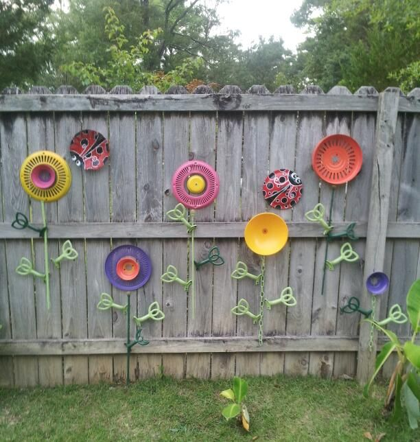 "Fence garden ... no watering required! Upcycled from ceiling fan parts. By ""Bless Your Heart Art""  kathryncrews@comcast.net"