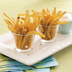 40 Party Appetizer Recipes | Salt-and-Pepper Oven Fries | SouthernLiving.comFries Recipe, Southern Living, Ovens Fries, Lemon Garling, Dips Sauces, Baking Fries, French Fries, Salts And Pepp Ovens, Lemon Garlic