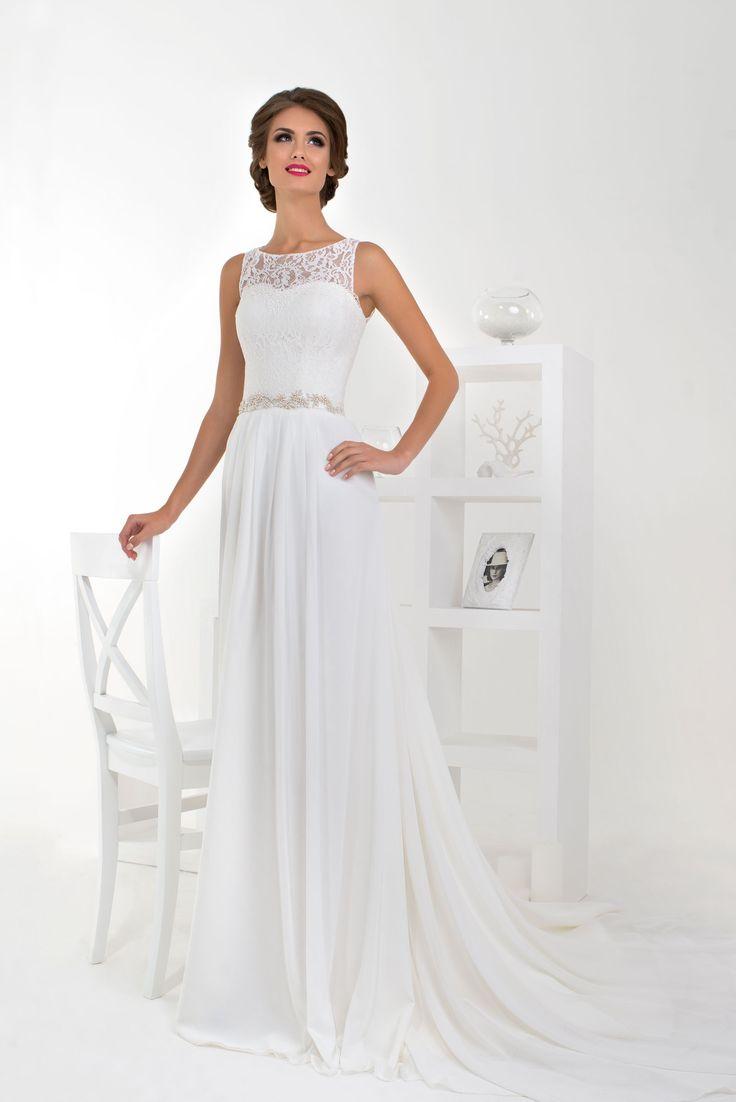 Krásne svadobné šaty s jednoduchou padavou sukňou a krajkovaným živôtikom zdobené opaskom