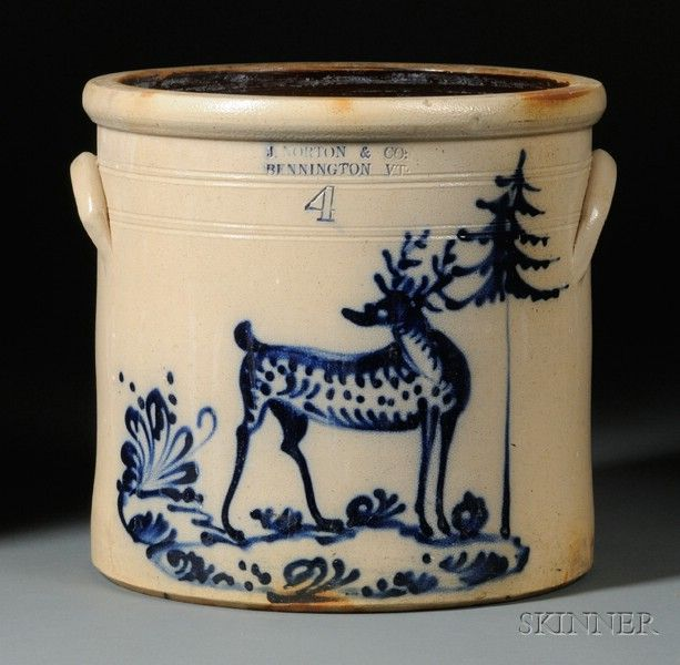 "Bennington Stoneware Crock with Cobalt Blue Stag, J. Norton & Co., Bennington, Vermont, 1859-1861, four-gallon straight-sided crock, decorated with a freehand stag in a landscape with a pine tree and incised lines about the shoulder, Albany slip-glazed interior, lug handles, impressed maker's mark ""J. NORTON & CO. BENNINGTON VT.,"" ht. 11 1/2 in.  Very good condition, just a very small unobtrusive 1/4 in. shallow interior rim edge chip, no cracks, black light shows no repairs Sold $ 23,700"
