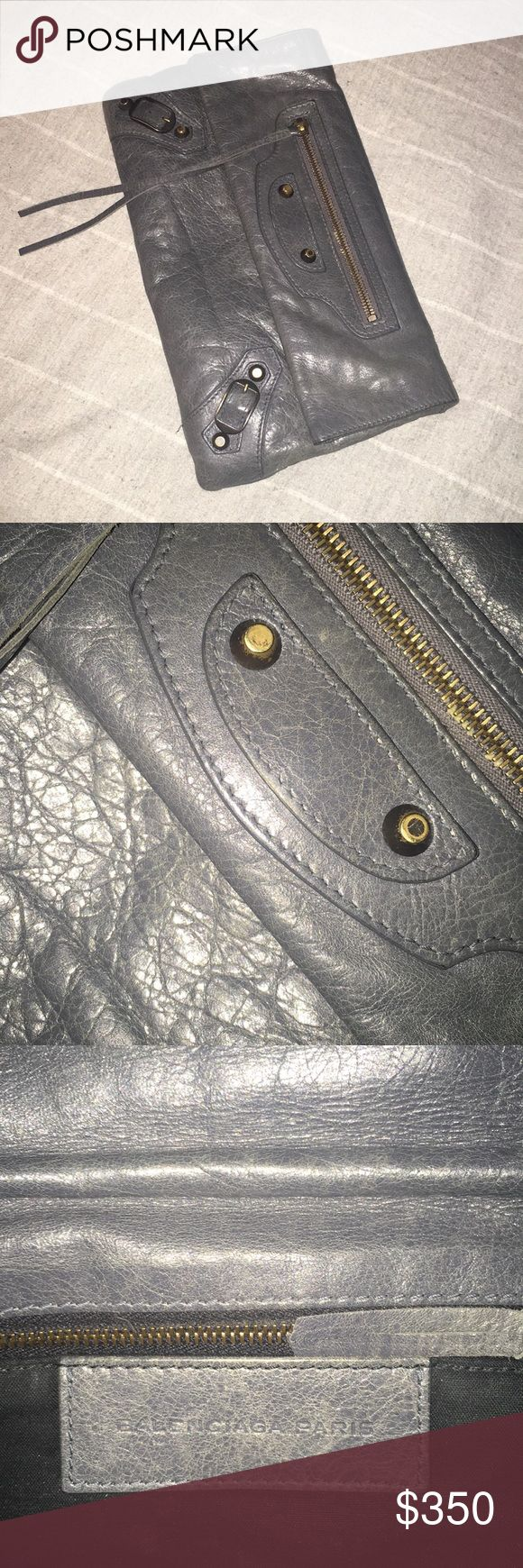 Balenciaga Clutch Dark grey, super soft clutch. Love but not as daily use and not worth keeping in the closet! Bought off tradesy awhile back (listing original price for what I bought it for) Balenciaga Bags Clutches & Wristlets