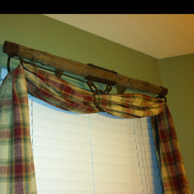 Old farm equipment for a curtain rod.