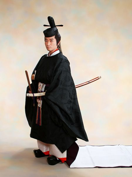 A man wearing heian robes.