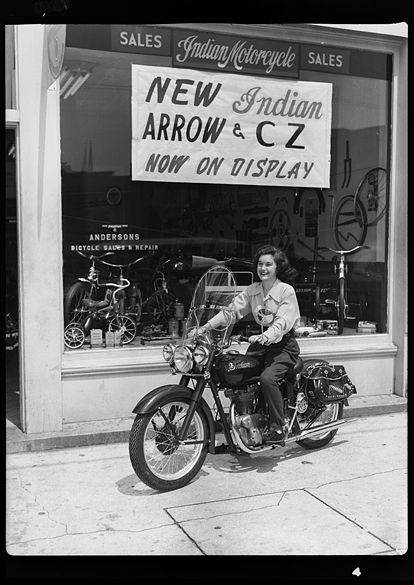 Woman sitting on a 1940s Indian motorcycle in North Carolina (exact location not yet identified). It's unlikely that the woman in this photograph was also the owner/rider, but I'd give this photo extra awesome points if she was. Click on the link to read more about this photo, which is part of the Hugh Morton Collection at UNC Chapel Hill.