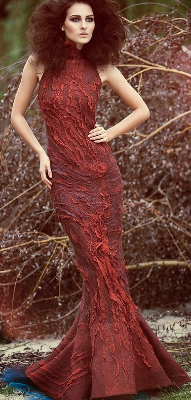 Diana Nagorna...... she is my favorite designer that uses Nuno felting....her clothes are incredible!!!  Extremely talented!!!!