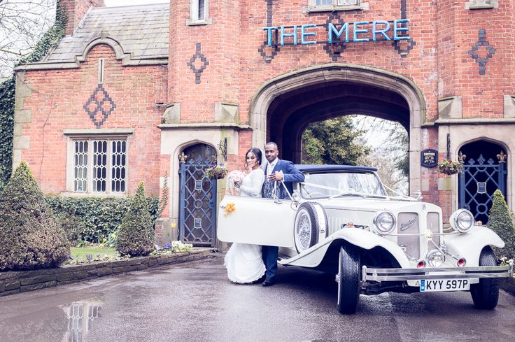 A Bespoke Dress for a Wedding of Two Halves at The Mere. Vintage white wedding car. Image by Jack Knight Photography. Read more: http://bridesupnorth.com/2016/06/13/culture-class-a-bespoke-dress-for-a-wedding-of-two-halves-at-the-mere-cheshire-khadiga-ahmed/