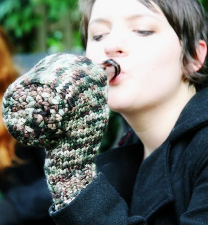 "Hilarious and practical, this is a Midwestern dream knitted mitten pattern designed to hold a ""beverage"" can or bottle."