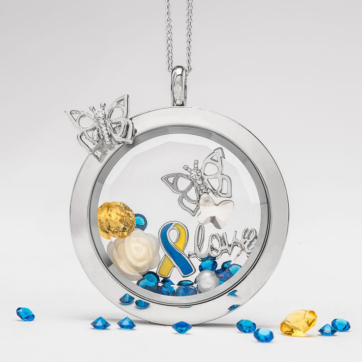 Today + every day we spread our wings + raise our voices to quiet the stereotypes. In honor of World Down Syndrome Day, please join Origami Owl in showing your support + love with our new Down Syndrome Awareness Ribbon Charm.