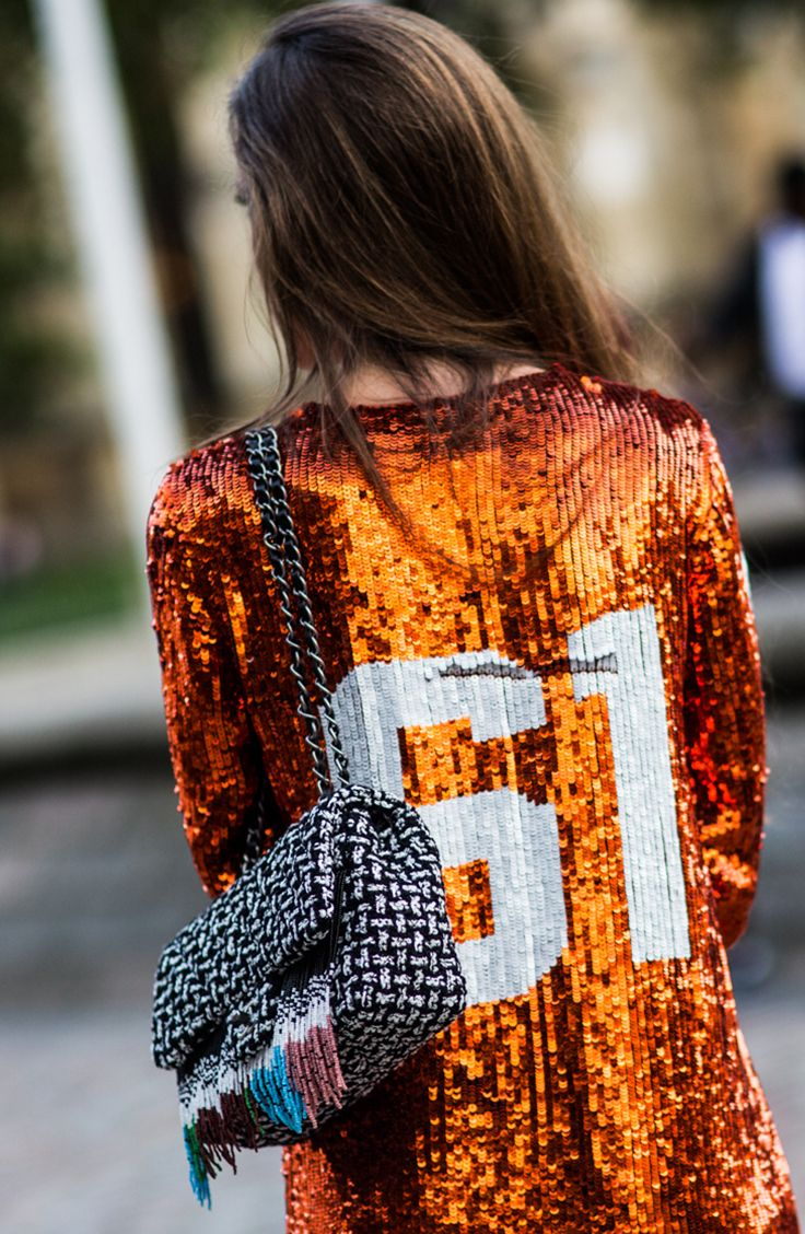 Mix prints and textures: sporty sequins + a surprising, nubby tweed bag. The best street style from London Fashion Week