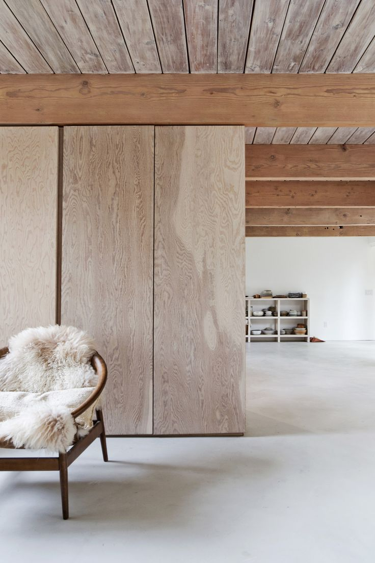 Timber in this interior has been used in various applications to add a refined visual interest to an otherwise simple room. The moveable room dividers are a very clever design to help physically and visualy divide up the space for a more intimate feel.