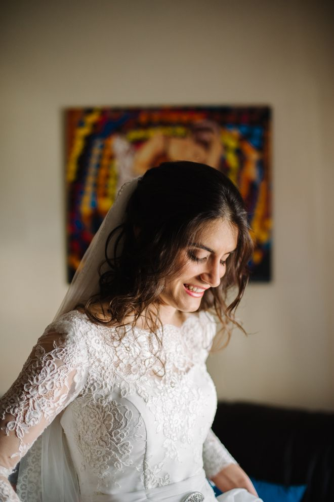 Joana looking fantastic in her lace wedding dress! So beautiful! More here: http://www.fotografamos.com/2013/05/15/joana-jorge-wedding-casamento/