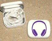 Recycle Altoid tin and keep earphones from tangling around everything in my bag!