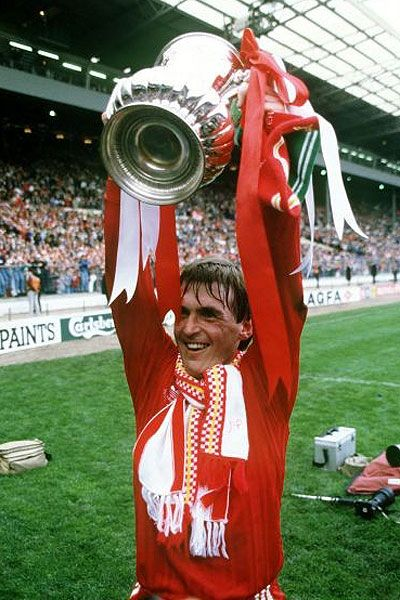 Kenny Dalglish celebrates winning the FA Cup at Wembley in 1989