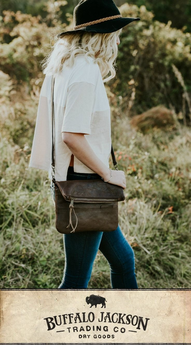 cadbef351c Soft brown leather foldover clutch with strap. Adjustable strap is  removable to work with any outfit as a purse, crossbody bag, or clutch.