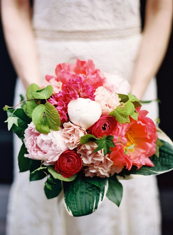 Love the different shades and hues of colours here from soft pink and white to fuschia and coral to dark and light green leaves.