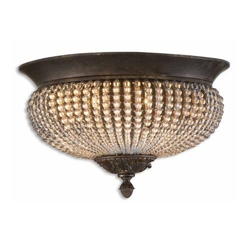 flushmount light with clear glass in golden bronze finish