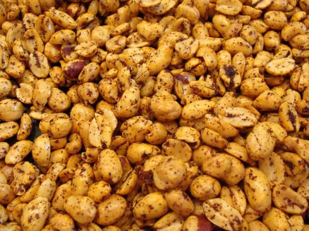 Hot and Spicy Peanuts from Food.com:   Wow! These peanuts are addicting! They are easy to make and would be great for a party. Make sure to drain very well after cooking or they will be greasy. The recipe comes from the Betty Crocker Christmas cookbook.