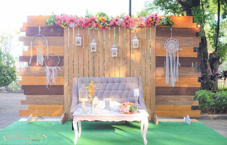 Rustic Setup | Wooden Backdrop; Grass Mat; Tufted Couch; Coffee Table; Faux Flowers; String Lights