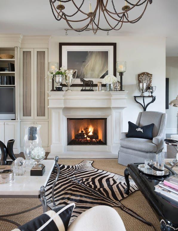 This zebra rug anchors everything in the room for Living room ideas with zebra rug