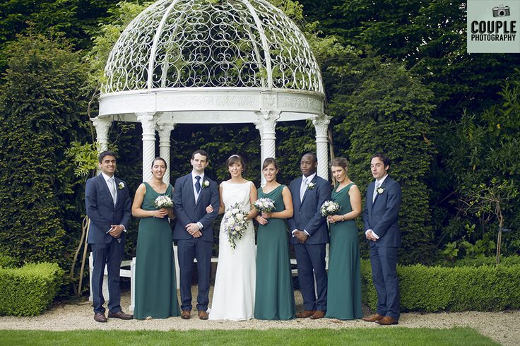 The whole bridal party in the beautiful, colourful grounds of the Keadeen Hotel. Weddings at The Keadeen Hotel Photographed by Couple Photography.