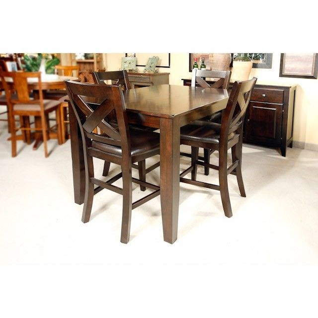 The Dark Mango 7 Piece Pub Set is a dapper addition to your home! The rustic charm is crafted from solid Mango wood in a dark Caribbean Cherry finish and accented with rounded corners, tapered legs, burnished edges and light distressing. The table includes a self-storing 18