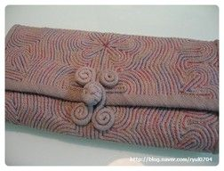 """Korean embroidery with dyed threads, called """"sek shil nubi"""". It's almost sashiko-like, and usually done on small items like pouches and pincushions. 