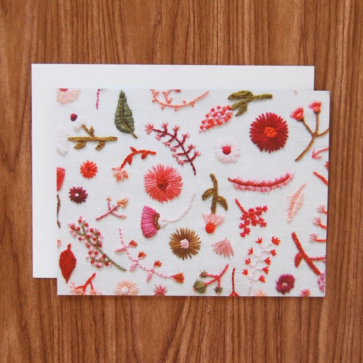 This product marries two of my favorite things: hand embroidery and the handwritten note. A high resolution photo of my hand embroidered red and pink flowers on white linen was reproduced onto a heavy