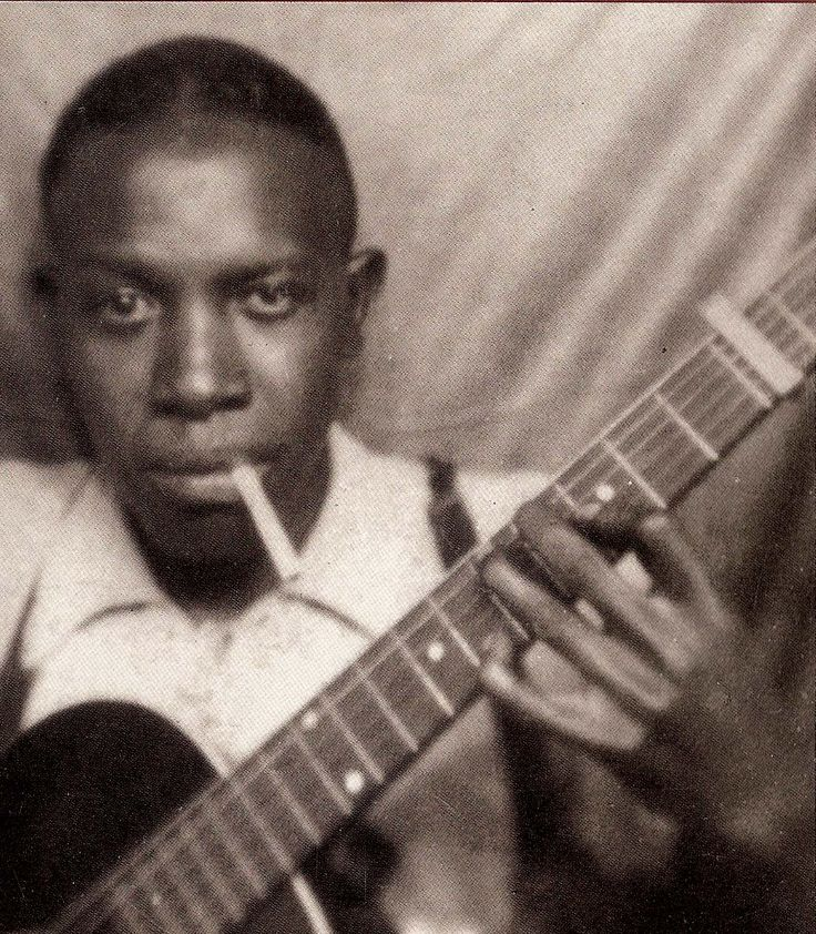 Robert Johnson - blues guitarist whose music influenced famous rockers such as Led Zeppelin and Clapton