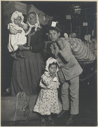 Lewis W. Hine. Italian Family Looking for Lost Baggage, Ellis Island, New York. 1905
