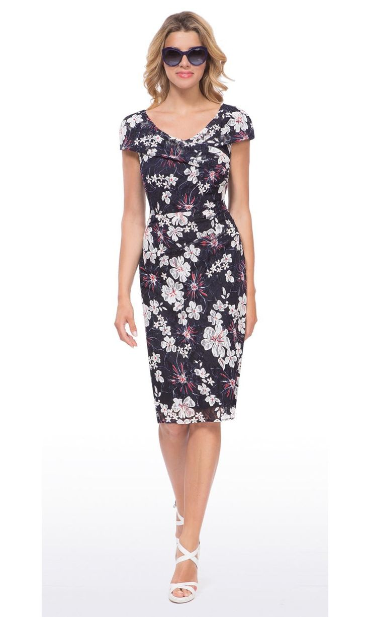 Michaela Louisa 8451 Navy The red and white flower print is so fresh and is set off beautifully by the navy background. The collar detail is smart and fans out to become the cap sleeves so it elegantly covers your arms and flatters your neckline at the same time. The soft ruching to one side also makes it kind to your tummy as it doesn't cling. A smart day dress that is fab worn solo or team it with a hat and heels for a wedding or a posh event. Superb value for money too at £99…