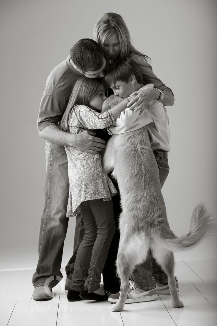 makes me smile. I want a family picture like this one day, but I have a feeling there will be more than one pooch in the picture :)