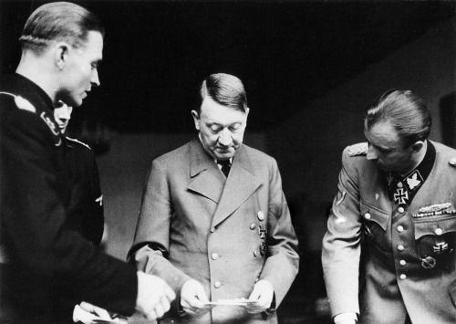 Adolf Hitler, Max Wunsche and Hermann Fegelein, Hitler's 55 Geburstag, 20 Apr 1944. (via jochenmarseille) Heartbreaking photo of a broken man with the wretchedly odious Fegelein on the right. (via putschgirl)