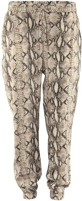 £ 15 - Printed trousers from H+M are so on trend and look best with a chunky knit cardigan or jumper. Converse will top this look off perfectly