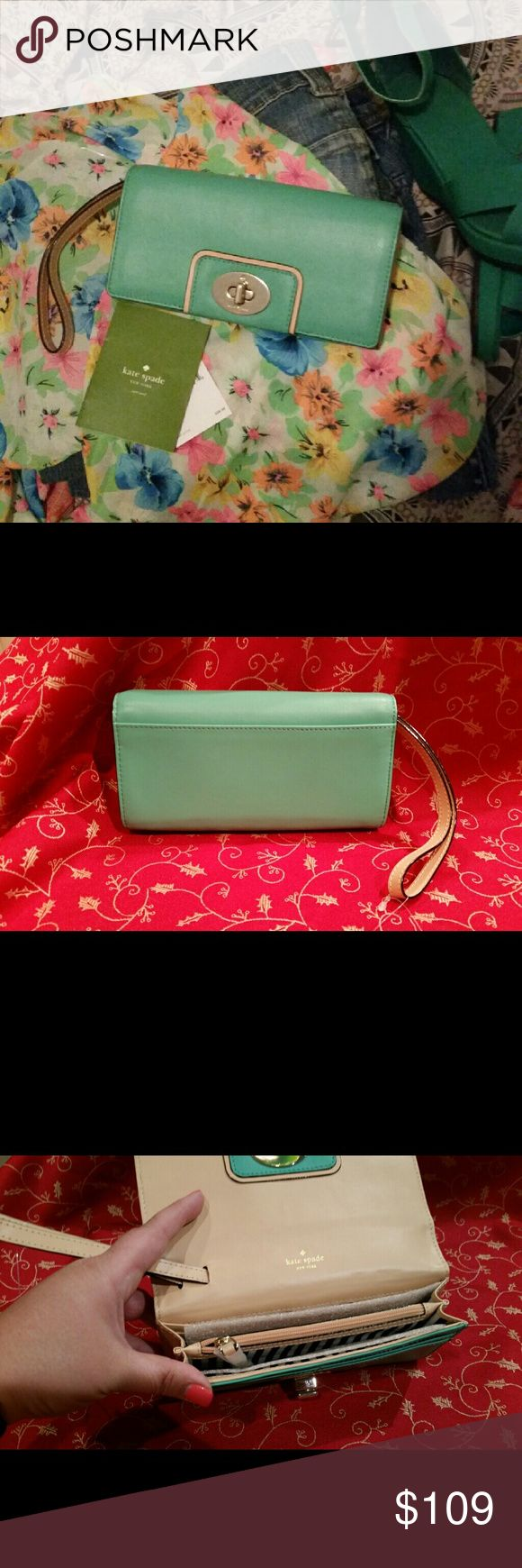 Kate Spade Turnlock Wallet SALE!! Brand new with one blemish in the leather on the front of wallet as shown. Hard to see in person without looking for it.  The zoom and lighting magnified it. Aquacove (941) coveted color.  Mara WLRU1598.  Former Smoking and pet friendly home. kate spade Bags Wallets