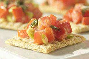 Bruschetta on crackers! As simple as they are to make, these tasty appetizers are guaranteed crowd-pleasers.