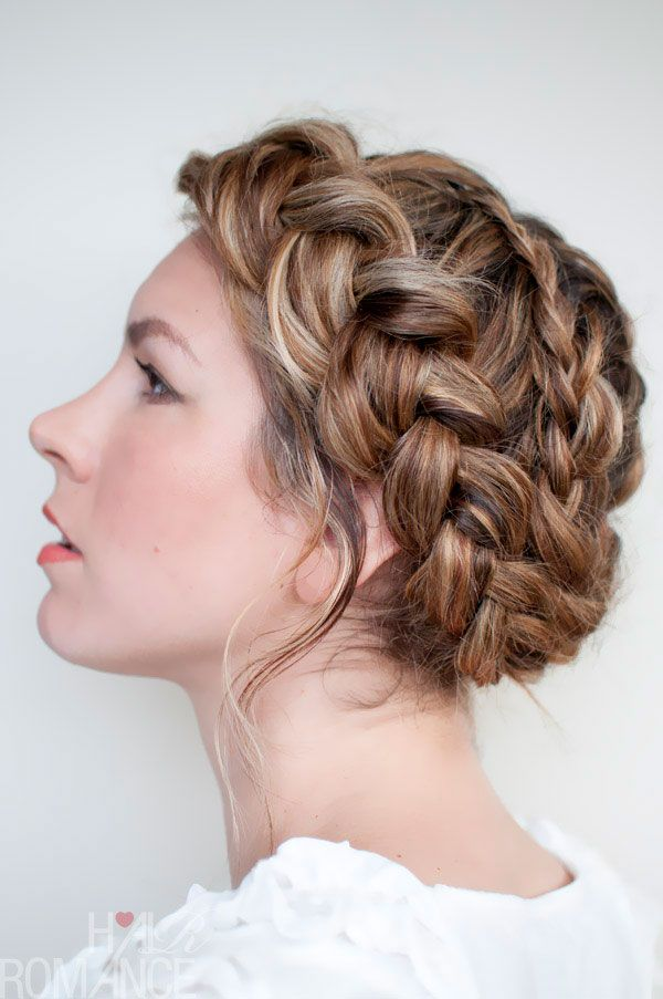 "Site text: This hair style consists of two Dutch braids, one going clockwise and one going anti-clockwise. It gives the updo a similar crowning effect, yet doesn't look as neat as the ""regular"" halo braid."