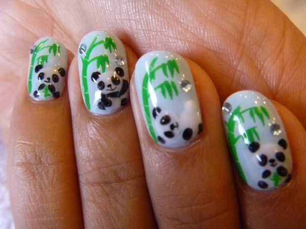 Amazing panda nails - When I tried this design it turned out pretty cute, though (as always) not as good as this picture, the picture I got inspiration from. One thing that I did change when I imitated the picture was to apply a darker blue for a background do the pandas stood out a little more.