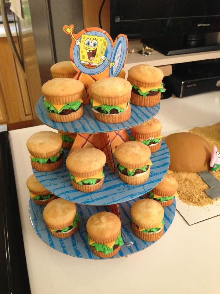 vanilla cupcakes, fondant tinted yellow, buttercream icing tinted green and chocolate cupcakes to make the krabby patties.