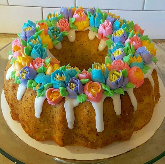 Easter bundt cake with buttercream flowers using Russian piping tips.